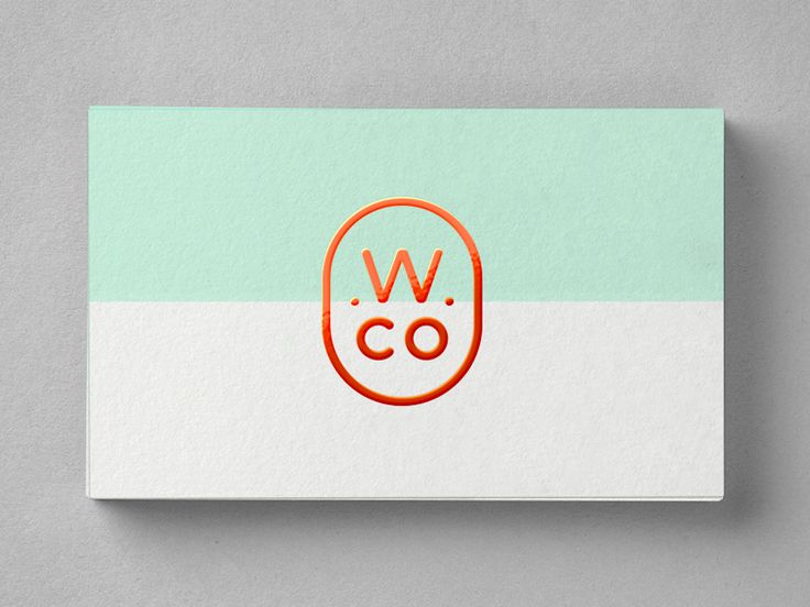 The design for Wondrous Co. business cards, following the style and palette of the website. Simple two colour with a reddish orange spot UV accent for the W Co emblem.  (This is a mockup)