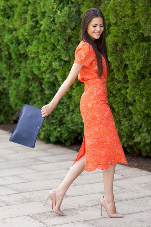 Lace is always a good idea for a fall wedding. Opt for one in an unexpected hue, like this gorgeous tangerine.