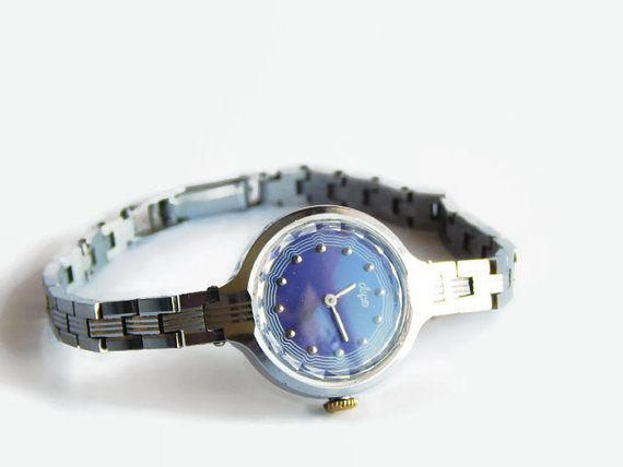 """Cocktail watch made by Minsk Watch Factory. The strap is adjustable and a flex mesh type. Watch is in fully working order, professionally serviced. Definitely still ready to be worn with pride. Made in USSR. Case measures: 1 (2,5 cm) in diameter. Each part of the strap is about 3"""" (7,5"""