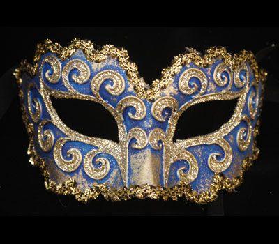 La ricciola blu V05 - Maschera originale veneziana realizzata a mano in cartapesta, colori acrilici, glitter e decorata con passamaneria. Forma e disegno della decorazioniparticolarmenteoriginali.