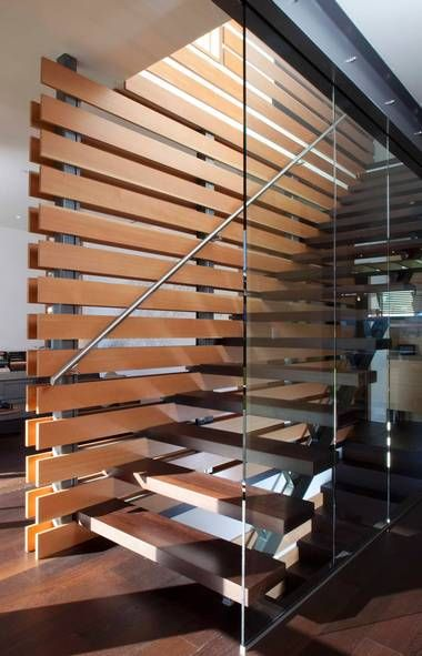 Glazing on one side of the staircase helps give it an open feel, and fir slats on the other were used to keep the wall translucent. They also connect the inside of the West Vancouver home to its outside, with those same slats used on the carport. Designed by Kevin Vallely, while he was with Kallweit Graham Architecture. (Photo by Peter Powles)