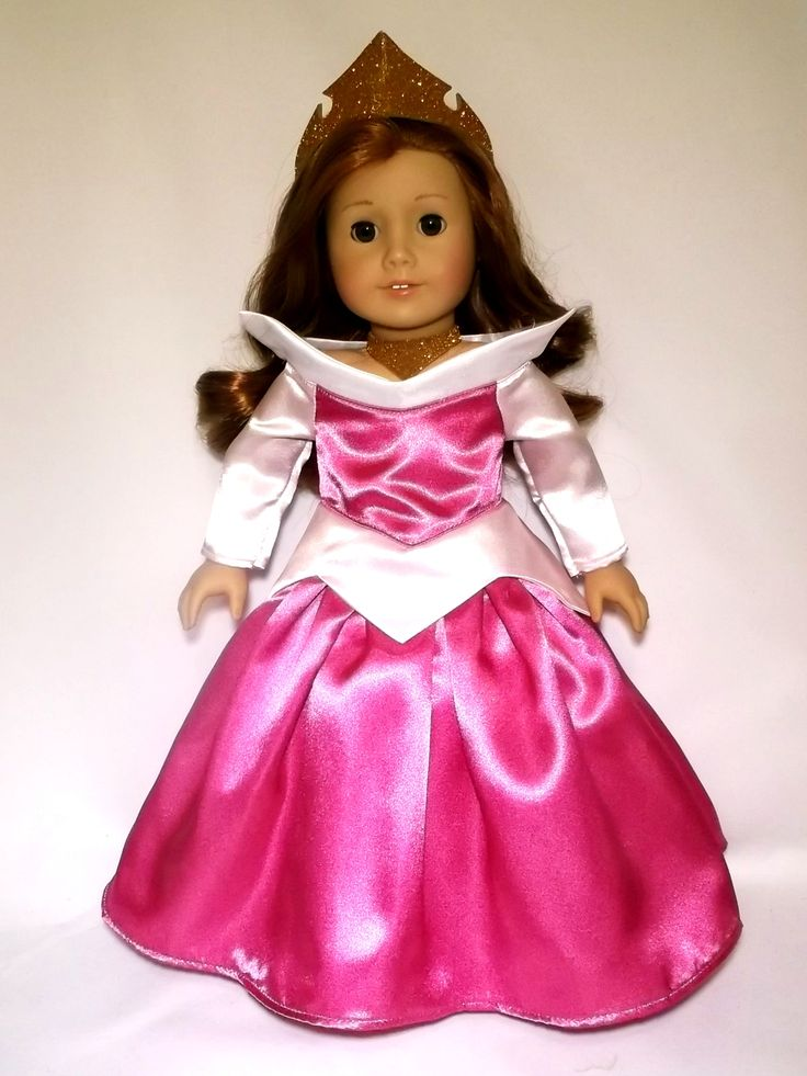Turn your doll into Disney Princess Aurora with this beautiful dress made with satin fabric, bodice lined and Velcro closure in the back. This listing is for the dress, crown and necklace only. The do