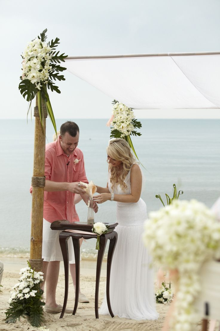 White and coral beach wedding Weddings in Thailand