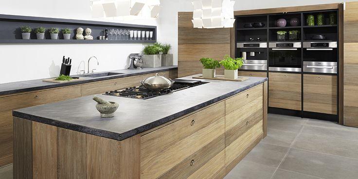 Houten kookeiland met betonnen aanrechtblad, koken als een sterrenkok