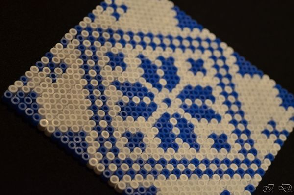 Hama / Perler beads mural decoration or maxi coaster made by Isa D. Inspiration from a stitching pattern.