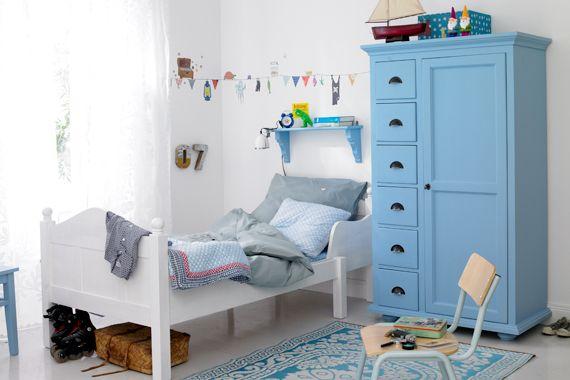 children's room, kids room with white bed and blue wardrobe Kinderzimmer mit weißem Bett und blauem Kleiderschrank