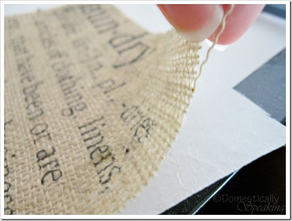 Run burlap through your printer!  Tutorial at http://www.domestically-speaking.com/2010/09/burlap-laundry-signhow-to.html
