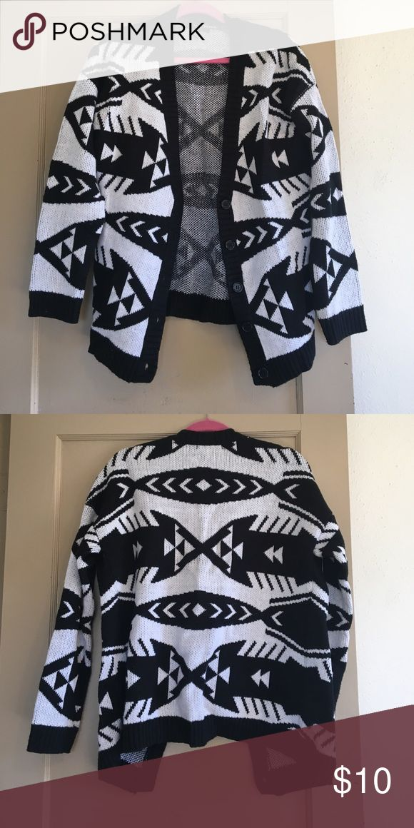 Black and white cardigan Black and white print cardigan, never worn! Has buttons about halfway down to the bottom. Forever 21 Sweaters Cardigans