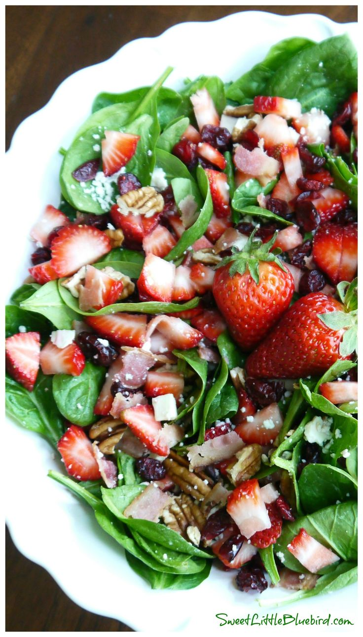 SPINACH STRAWBERRY SALAD - gorgonzola, bacon, pecans, dried cranberries topped with a wonderful balsamic dressing. Darn delicious! | SweetLittleBluebird.com