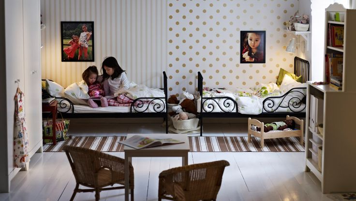 Cute room for sharing from IKEA.  Each child has different but complementing wall paper so it looks like a separate space but works together.  Great idea!! LOVE these beds.  My youngest has the white version and it is great.
