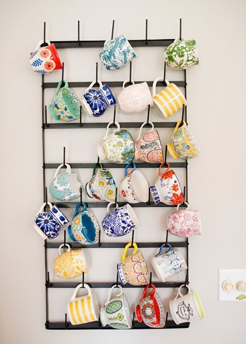 This blogger's coffee cup collection doubles as colorful wall art, punching up a plain wall in her mostly-neutral space.Click through for more on how to organize coffee cups.