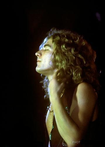 robert plant.  this is probably one of the most gorgeous pictures I've ever seen taken of him