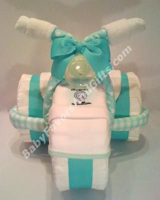 Unique baby shower gift ideas: Today you can find 1000's of diaper cakes - each one offering its own style, each one a unique creation, but all have one thing in common they are round