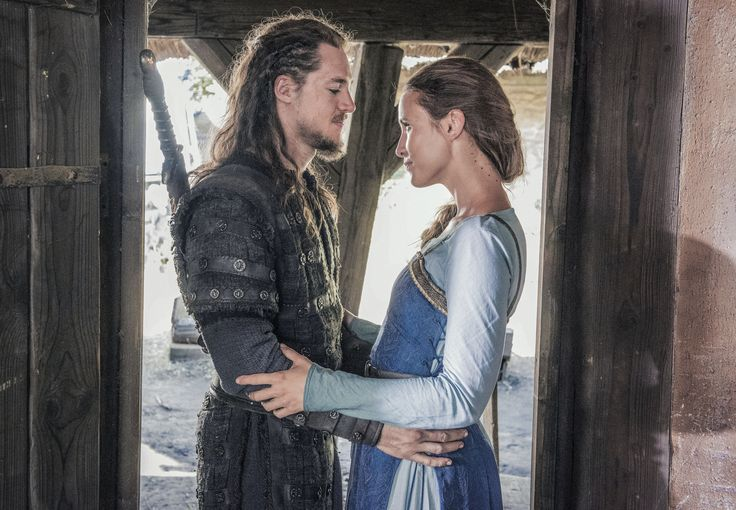 """Alexander Dreymon as Uhtred of Bebbanburg (with Peri Baumeister as Gisela) in """"The Last Kingdom"""" Season 2 From http://www.farfarawaysite.com/section/lastkingdom/gallery2/gallery6/gallery.htm"""