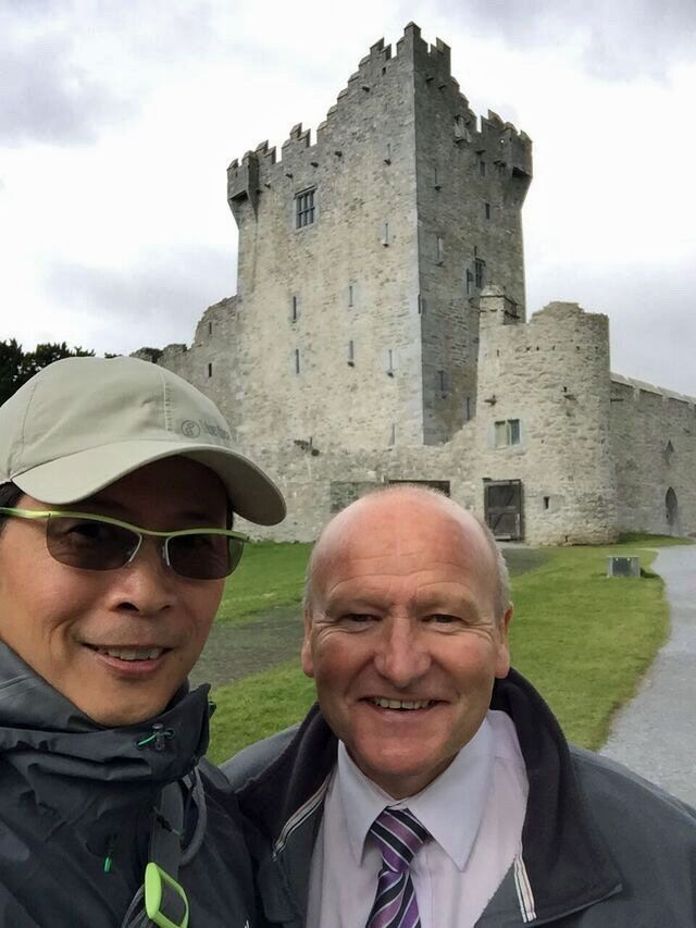 Tour driver/guide Mike Brady with Chris Lee from Hong Kong at Ross Castle as part of their week long tour of Ireland