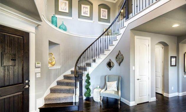 A Winding Staircase Graces The Entry Of This New Home At