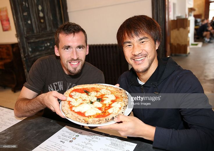 Christian Fuchs and Shinji Okazaki during Leicester City's visit to Peter Pizza, Leicester, after manager Claudio Ranieri kept his promise of pizza for his squad after keeping their first clean sheet of the season on October 29, 2015 in Leicester, United Kingdom.