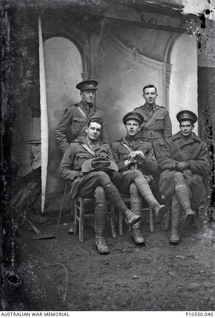 Group portrait of officers of the 5th Battalion. Identified are (back, l to r): 497 Lieutenant (Lt) Harold Maurice Griffiths MC; Lt John William Dwyer; Front: Cpt Thomas Karran MALTBY, Cpt Eric Geo de Trembley Permezel MC, Lt Geo Leslie Makin.