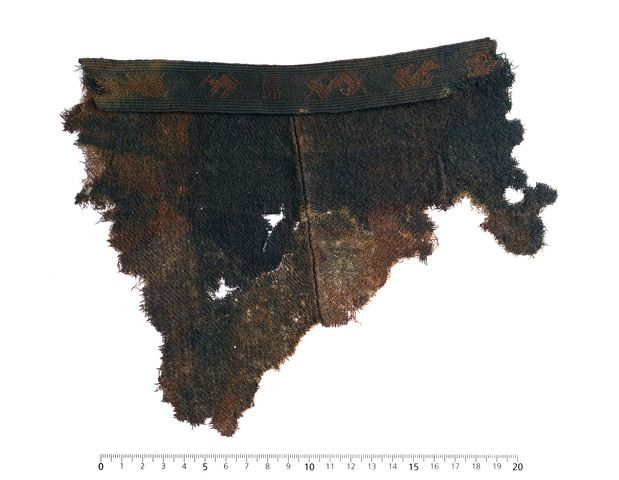 Wool twill and brocaded, patterned tablet weaving from the grave of the Chieftain from Evebø/Eide, Nordfjord, Norway. ca. 475 CE. Museum : Universitetsmuseet i Bergen.  MuseumNo : B4590.