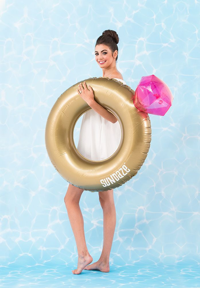 This giant ring pool float won't go un-noticed at your bachelorette party, engagement party or beach themed wedding celebrations. Super-sized bling and inflatable fun combine for a swimming pool float perfectly suited for some wedding related merriment. Made from sturdy metallic gold pvc with a humongous pink diamond, this novel inflatable pool float will make a perfect prop for those must have insta-worthy photos!