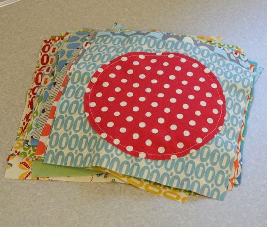 This circle quilt would be great if you used your kids grown-out-of clothes for the circles.