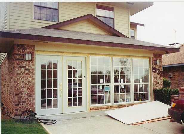 I like the idea of replacing the garage door with French doors and large  windows. Seems like it would be an easier transition