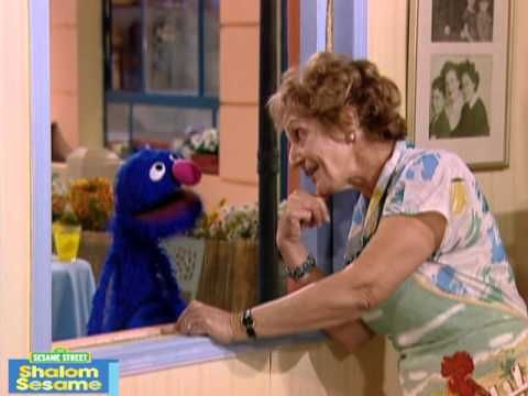 "It's almost Shabbat! Everyone is busy getting ready for the holiday but Grover doesn't know what ""Shabbat"" is. Shoshanna shows Grover the me..."