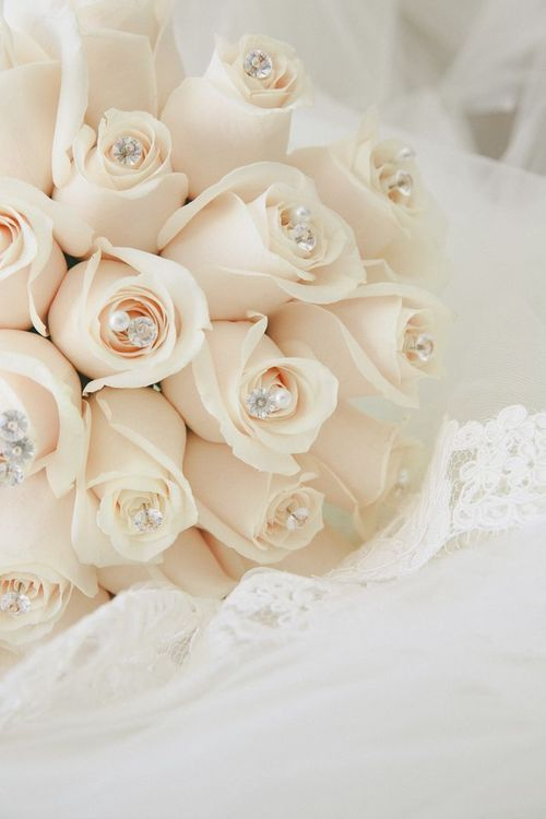 Cream colored roses with diamonds oh my