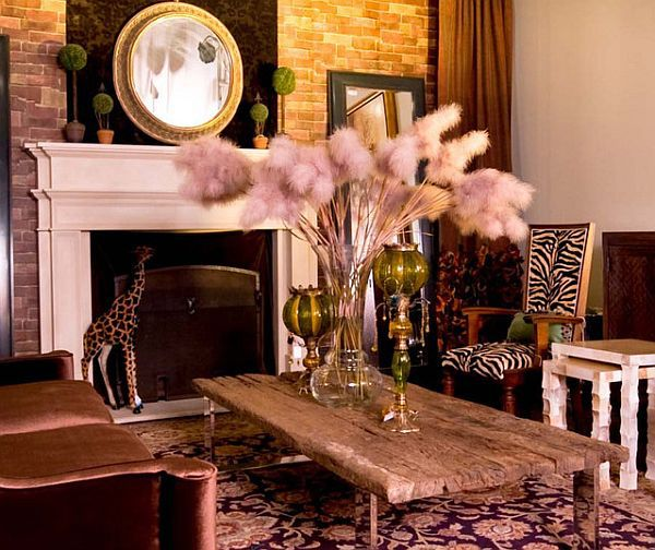 Image from http://interiordesignblogg.com/wp-content/uploads/2015/06/Rustic-Touch-of-Safari-Themed-Living-Room-with-Wooden-Coffee-Table-and-Elegant-Sofa-Decorated-with-Giraffe-Statue-Next-to-Fireplace.jpg.