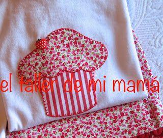 Conjunto para niña bordado a mano con diseño de magdalena. Estampado de flores y rayas.