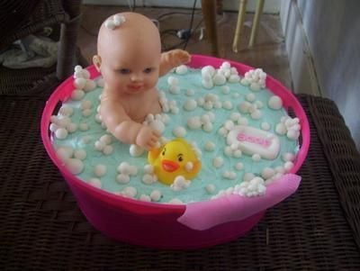 Bathtime Bubbles Cake: I made this adorable bathtime bubbles baby cake. I purchased a plastic party tub, plastic baby doll and a rubber duck.