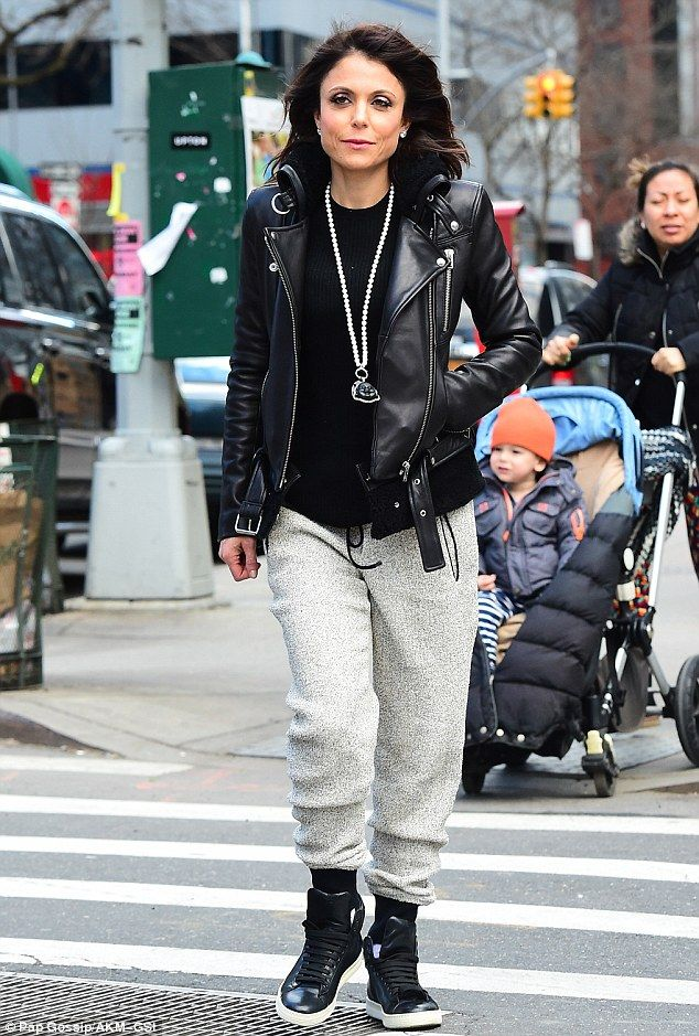 Cool mom: The TV star looked hip in sweatpants, high-tops and a biker jacket...