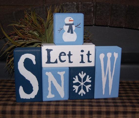 Let It SNOW Snowman Wood Sign Shelf Blocks Primitive Country Rustic Holiday Seasonal Home Decor. $34.95, via Etsy.