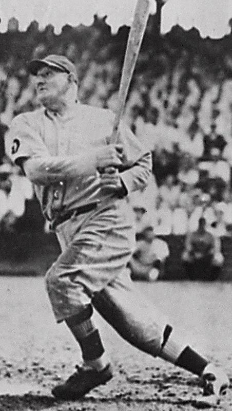 Honus Wagner, Pittsburgh Pirates.  This is a famous picture of Honus.  Not many people realize this but he is much older here.  Likely an old timers game or him as a coach hitting some balls.