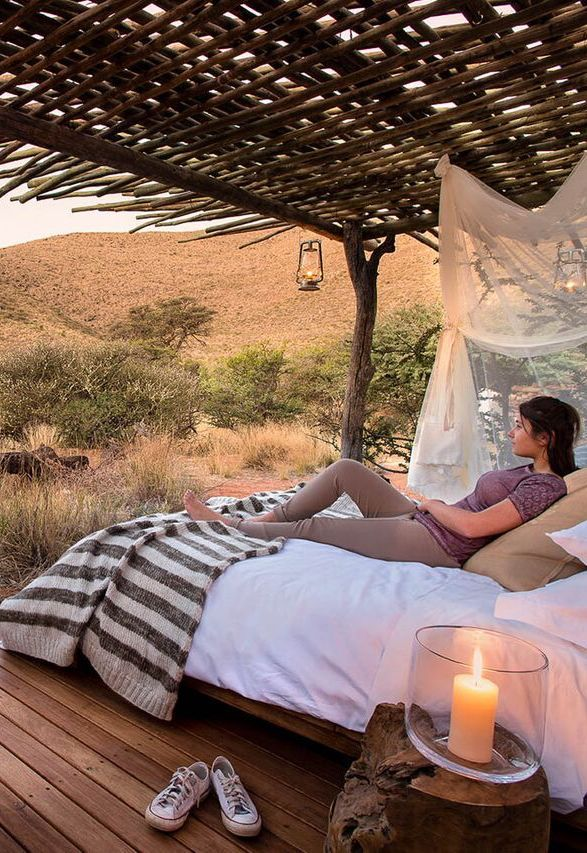 Sleep under a canopy of stars in the dry South African Kalahari air where no light pollution dims their brilliance. The raised sleep-out platform, called Malori or 'dreamer', has a thatched overhang and weather-proof blinds. Here, in a safe environment, you can immerse yourself in the Kalahari and feel the romance of its night skies. Timbuktu Travel.