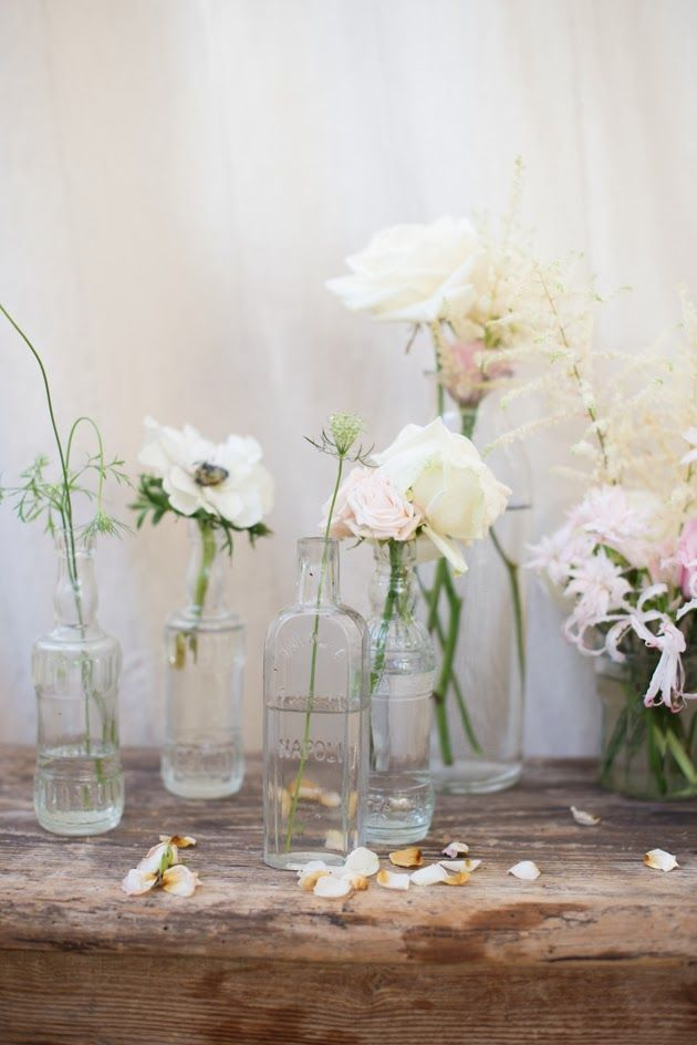 glasses and jars with simple blooms