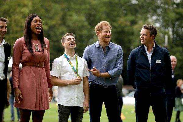 Prince Harry Photos Photos - Prince Harry (2nd R) jokes with photographers as he poses in a group photograph with (L-R) England netball player Eboni Beckford-Chambers, double-Olympic gold medalist gymnast Max Whitlock and former England cricket player Graeme Swann during an event to mark the expansion of the Coach Core sports coaching apprenticeship programme at Lord's cricket ground on October 7, 2016 in London, England. - Prince Harry Celebrates the Expansion of Coach Core at Lord's…