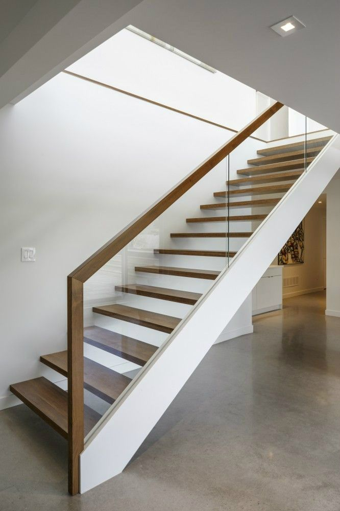 Top glass stair railing styling.  I like that it is thin, simple and modern.