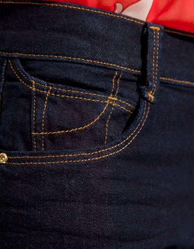 The coin pocket is the little pocket in the front. It is usually above another pocket.