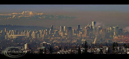 A view of downtown Vancouver and Mount Arrowsmith on Vancouver Island.  This was seen from Burnaby Mountain Park in Burnaby near Vancouver, British Columbia, Canada. Photo taken by me (Ann Badjura)