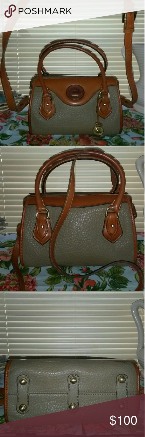 DOONEY BOURKE VINTAGE SATCHEL GORGEOUS Dooney & Bourke magnificent condition medium size  satchel. No spots, stains, or scuffs to outside. Very minor rubs on 2 corners dissappeared w conditioning! Inside has tiny ink mark pictured, very tiny. Rest of inside perfect. This bag holds alot of essentials for her med sz. It is 9.5 wide x 7in tall and 4.5 depth. Adjustable Crossbody/ shoulder strap, drop is 23in long. The british tan on bag and small handles is perfect color!, bottom w brass feet…