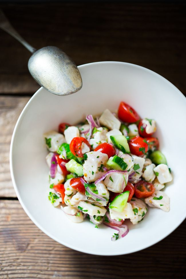 Easy Ceviche Recipe ...with fresh fish, chili, lime, cilantro, avocado, tomato and cucumber...a simple healthy appetizer perfect for Cinco de Mayo | www.feastingathome.com