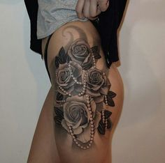 Roses and pearls on upper thigh