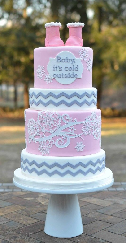 "Adorable winter baby shower cake! Love the ""Baby it's cold outside"" theme. Cute girly colors of soft pink, white snowflakes and gray chevron pattern."