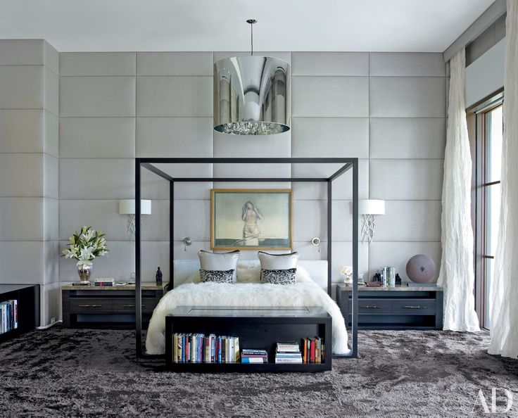 In the Palladian-style Florida home of art collector Becky Mayer, a bed by B&B Italia—like the outline of a cube—frames an artwork by Luis Caballero.