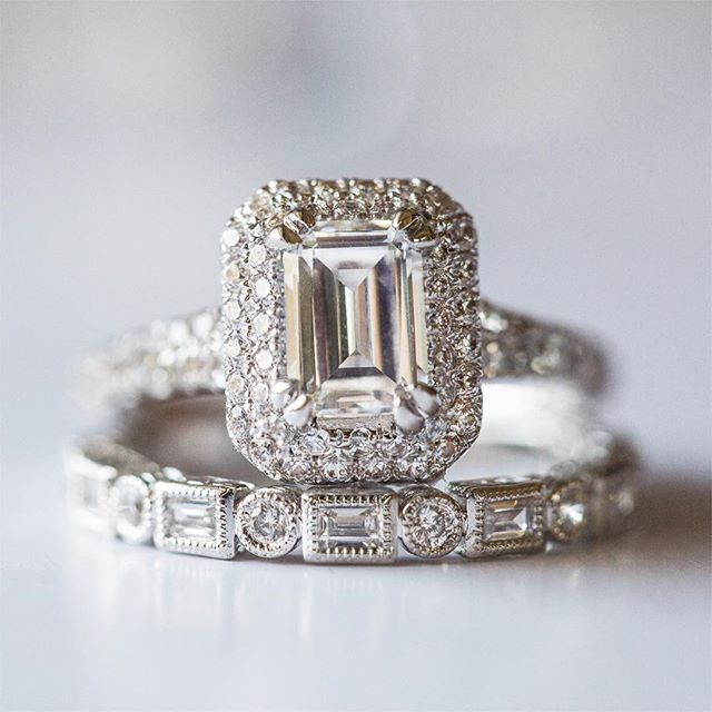 LOVE this wedding set! Well it's not really a set, but they go so well together! The double halo emerald cut diamond engagement ring and the delicate band with alternating baguette stones make this a unique and beautiful combination!