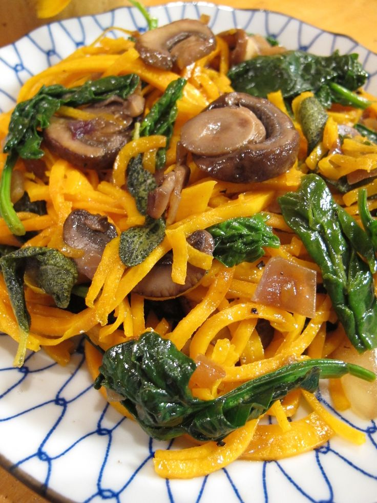 "Butternut squash takes a turn in the ""Spiralizer"" to create a healthy,  gluten free noodle that pairs well with this brown butter sage sauce, along  with spinach and mushrooms."