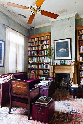 living room with old rug, wood, bookcases, fireplace, old world, eclectic, artistic
