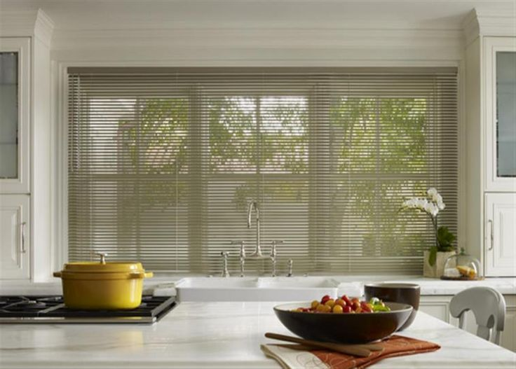 Metallic Finish Aluminum Blinds sets the tone for this beautiful kitchen.