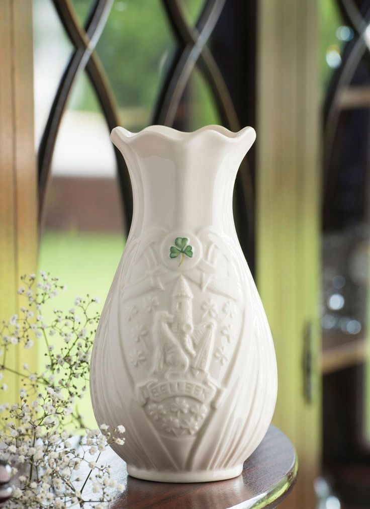 Trademark 7 Inch Vase Edition Piece: To memorialize Belleek's 160th year, Belleek has launched a special Vase Edition Piece. Crafted from Fine Parian China, this stunning piece portrays the distinguished Belleek Trademark.The vase features iconic Irish symbols including the round tower, the harp and shamrocks. #Belleek #China #Vase #FineChina #Irish #Harp #Wolfhound #Shamrock #Centrepiece #MadeInIreland